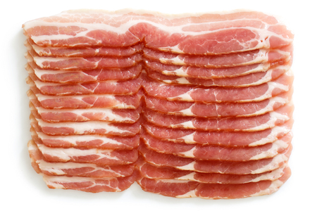 uncooked bacon: Many strips of streaky uncooked bacon isolated on white from above. Stock Photo