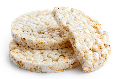 two and a half: Pile of two and half puffed rice cakes isolated on white.