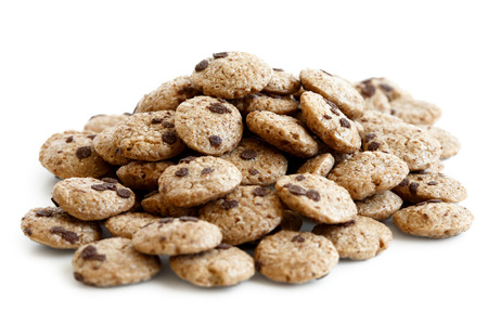 Heap of chocolate chip cookies cereal isolated on white.