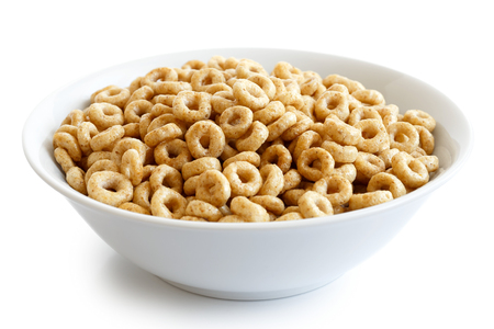 Bowl of honey cheerios isolated on white. Stock Photo