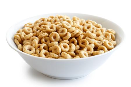 Kom honing cheerios geïsoleerd op wit. Stockfoto