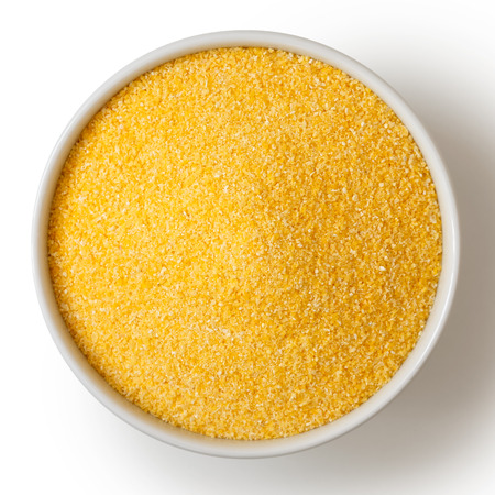 Cornmeal polenta in white ceramic bowl isolated on white from above. Stock fotó