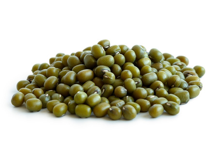 Heap of dry mung beans isolated on white. Фото со стока