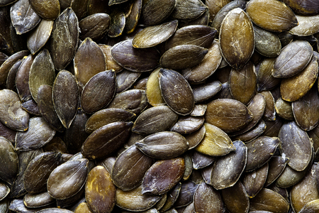 hulled: Background of hulled pumpkin seeds.