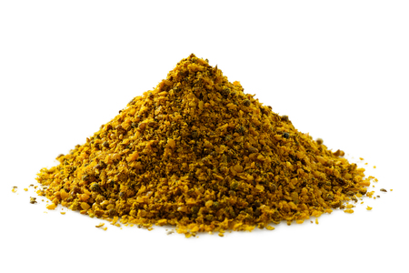 A pile of ground vindaye spice mix isolated on white.