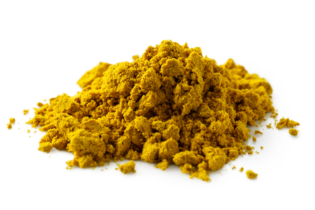A pile of curry powder isolated on white.