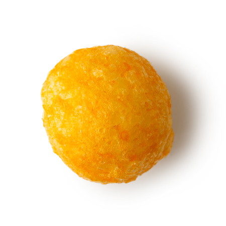Single extruded puffed cheese ball isolated on white from above.