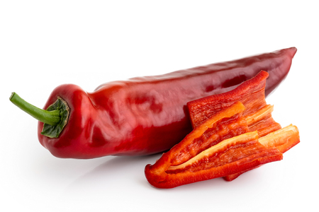 Ramiro sweet pointed pepper isolated on white and two cut pieces without seeds.