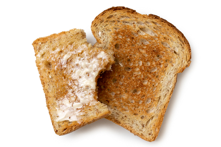half eaten buttered slice of whole wheat toast and whole dry stock