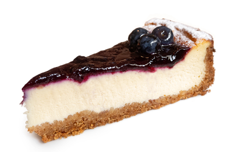 Single slice of blueberry cheesecake with fresh blueberries isolated on white.