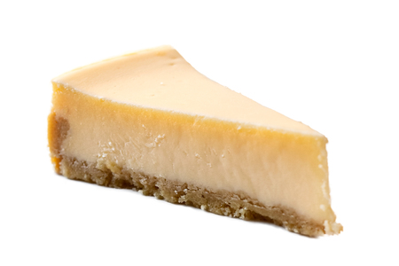 A slice of plain baked cheesecake isolated on white.