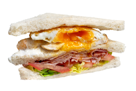 Bacon and egg club sandwich isolated on white.