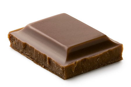 Single square of milk chocolate isolated on white. Rough edges. Imagens