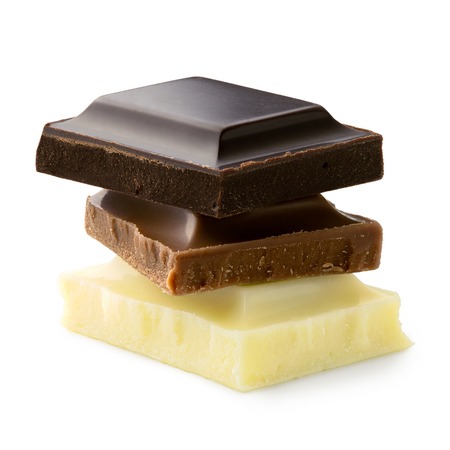Stack of chocolate squares: dark, milk and white chocolate isolated on white. Rough edges.