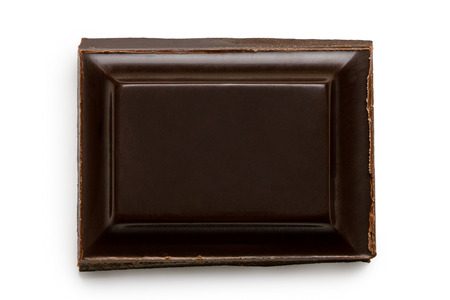 Single square of dark chocolate isolated on white from above. Imagens