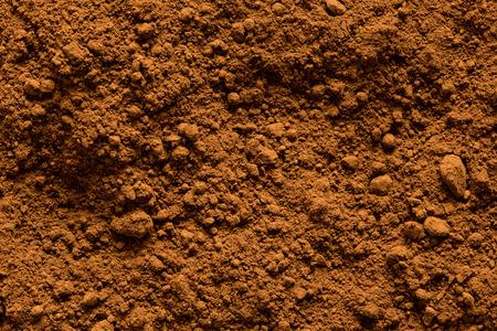 Sfondo di polvere di cacao macinata dall'alto.