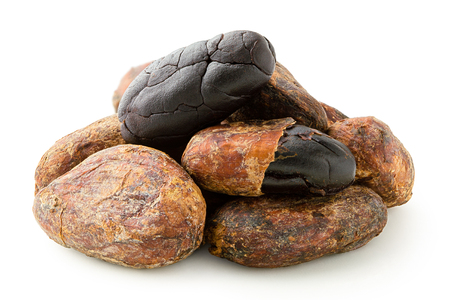 Pile of roasted unpeeled and peeled cocoa beans isolated on white.