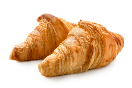 Two baked plain croissants isolated on white. Imagens