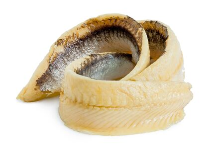 Two rolled anchovy fillets isolated on white. Stock Photo
