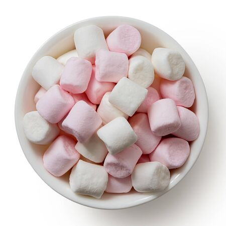 Pink and white mini marshmallows in white ceramic dish isolated on white from above. Stock Photo