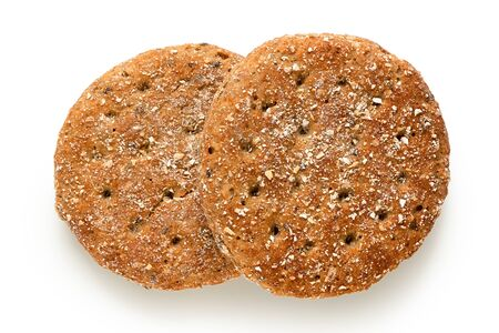 Two round oat wheat flat breads isolated on white. Top view.