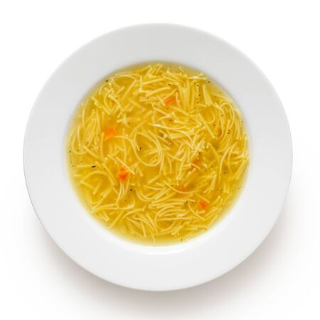 Instant chicken noodle soup in a white ceramic soup plate isolated on white. Top view. 写真素材