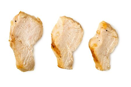 Three separated slices of grilled chicken isolated on white. Top view. Stock Photo