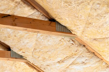 Glass mineral wool insulation in between roof rafters.