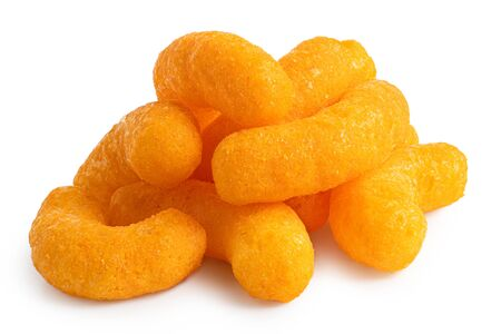 Pile of extruded cheese puffs isolated on white. Stock Photo