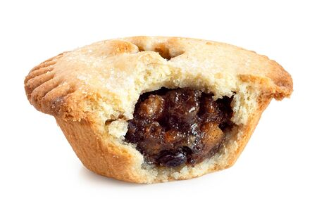 Broken open traditional british christmas mince pie with fruit filling isolated on white. Stock Photo