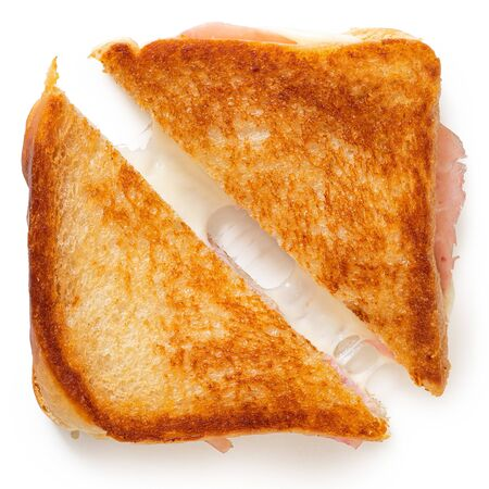Classic cheese and ham toasted sandwich cut in half isolated on white. Top view.