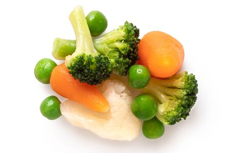 Pile of mixed vegetables isolated on white. Top view.