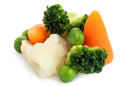 Pile of mixed vegetables isolated on white.