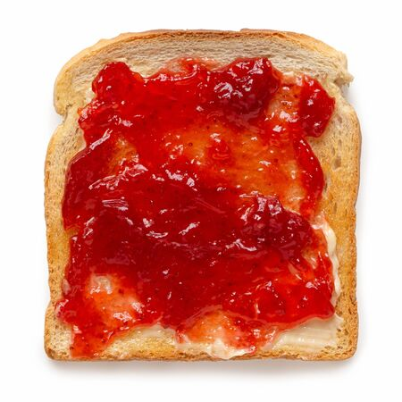 White toast spread with butter and strawberry jam isolated on white. Top view.