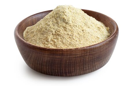Dried lentil flour in a rustic wooden bowl isolated on white. High angle.