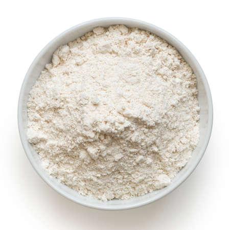 White bean gluten free flour in a white ceramic bowl isolated on white. Top view.