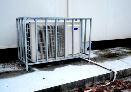 ventilate: Air conditioning compressor outside building