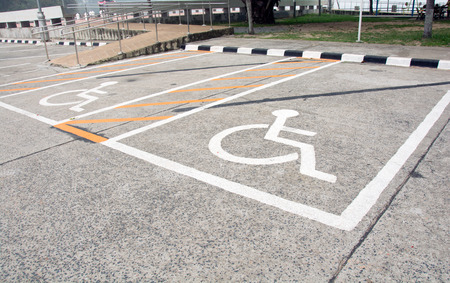 to designate: Handicapped Symbol Painted on a Parking Spot
