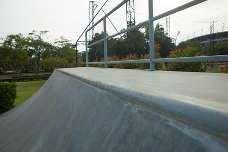 Outdoor concrete skateboard ramp at the park