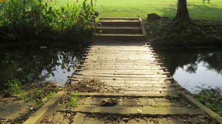 outdoor Wooden bridge over the pond , thailand Stock Photo