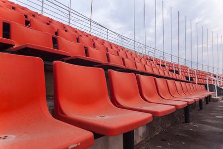 orange seat of football stadium in thailand Stock Photo