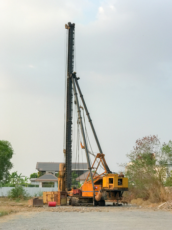 Foundation pile drilling machine in construction site Stock Photo