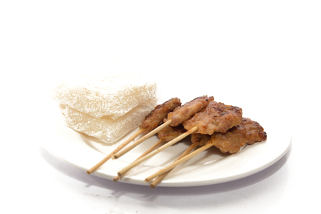 grilled pork served with sticky rice on white dish