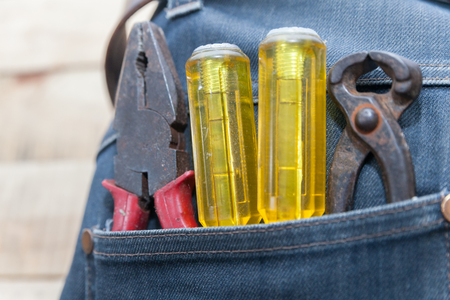 tools in jeans pocket, workman tool equipment