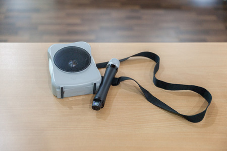portable amplifier speaker with microphone on table