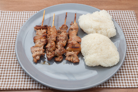 grilled pork skewer chop with sticky rice