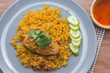 Chicken Biryani with rice and sauce. halal food (Khao Mok Gai) Stock Photo