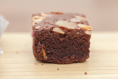 close up of of brownie cake on wooden plate