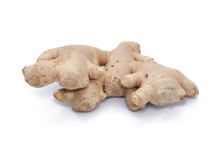 close up of root ginger isolated on white