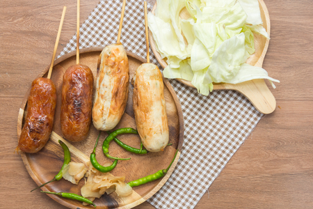 close up of thai style grilled sausage with vegetable